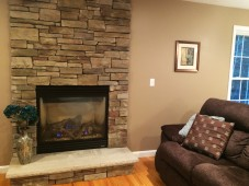 Gas fireplace with stone floor to ceiling surround