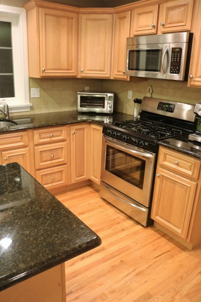 stainless appliances warm wood floors