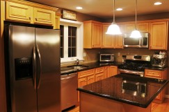 warm granite and stainless kitchen