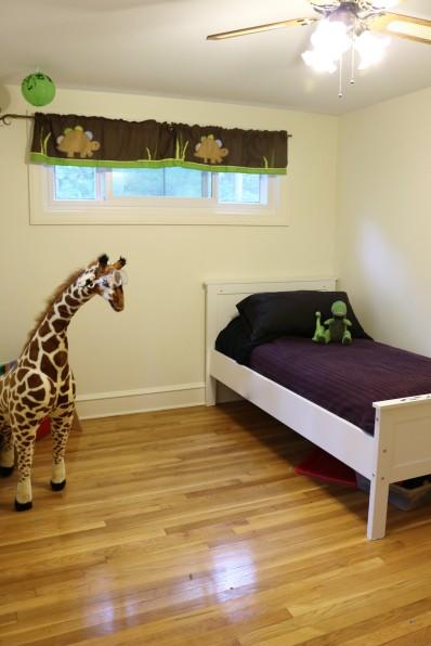 bedroom with gleaming hardwoods