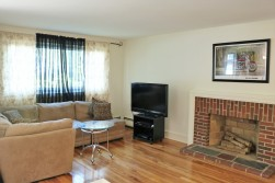 living room with hardwoods and fireplace.jpg