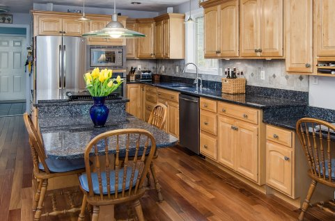 88 Slater Street kitchen with stainless appliances and blue pearl granite