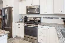 Kitchen with stainless appliances and gorgeous granite