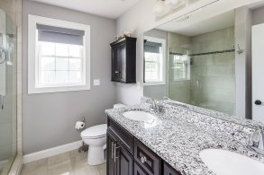 81 Avalon Drive master bath with glass shower and double vanity