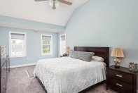 81 Avalon Drive master bedroom in silvery blue with vaulted ceiling