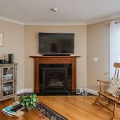 Living room with gas fireplace Unit 26, Mill Stream Village